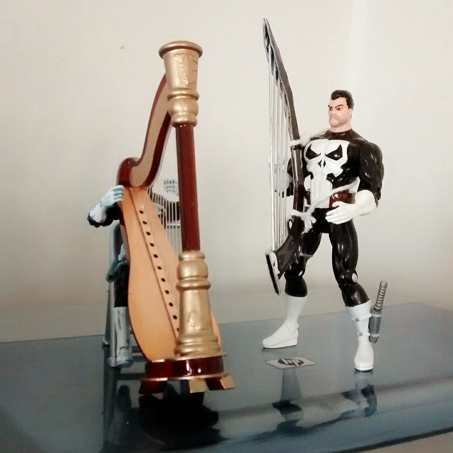 Here's a great duet performed by Marvel Universe's Punisher and the Toy Biz Punisher.