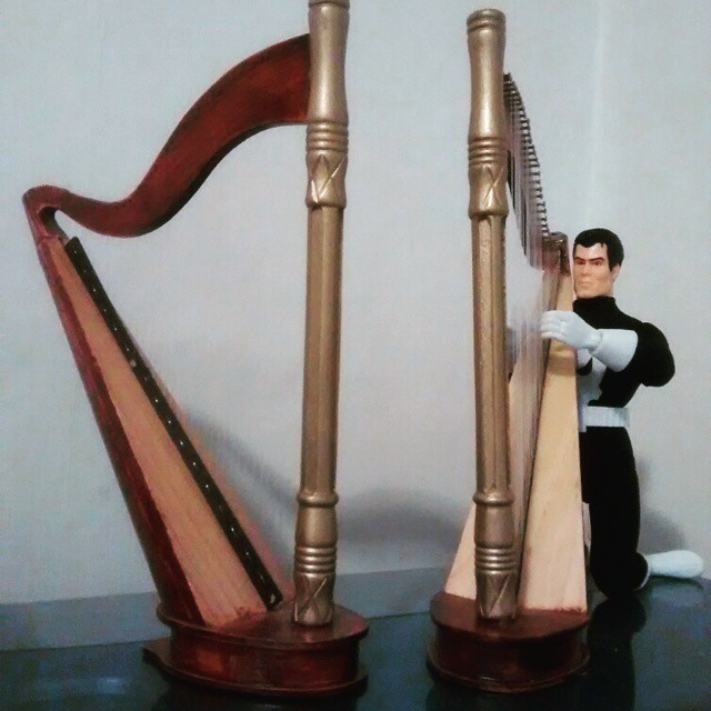 The Punisher practices his harp in the Practice Area.