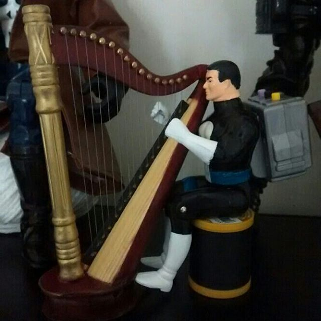Talking Punisher harps while wearing his backpack.