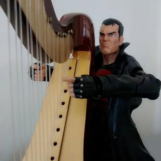 Thunderbolts Punisher variant is deep in his thoughts as he plays his harp.