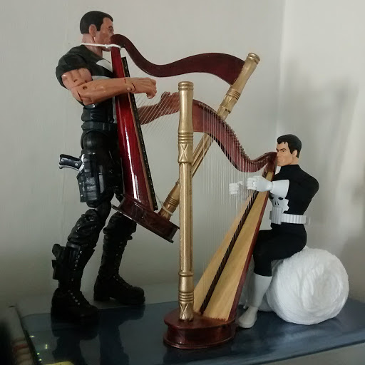 One Punisher figure is standing. The other is sitting down. Both is harping a duet.