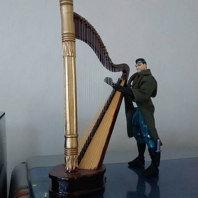 Punisher from Spiderman the animated series practicing his harp.