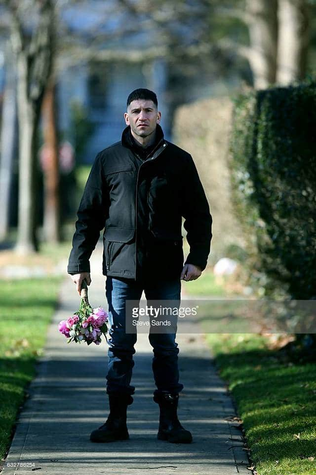 Jon Bernthal as The Punisher by GettyImages. Look he's holding a bouquet of flowers in this wonderful photo.